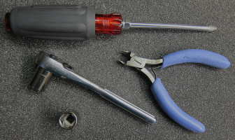 screwdriver, sockets and side cutters image