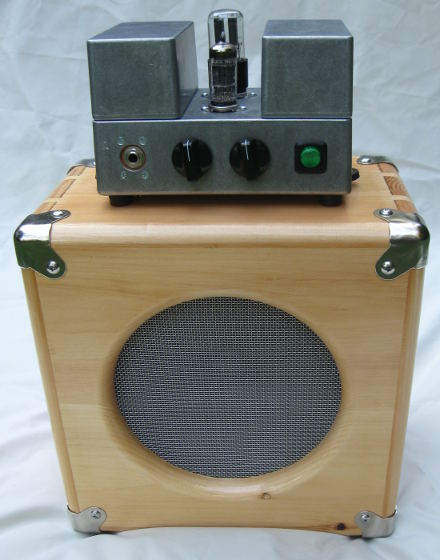 2w electric guitar amplifier head on top of a 108 pine speaker cab
